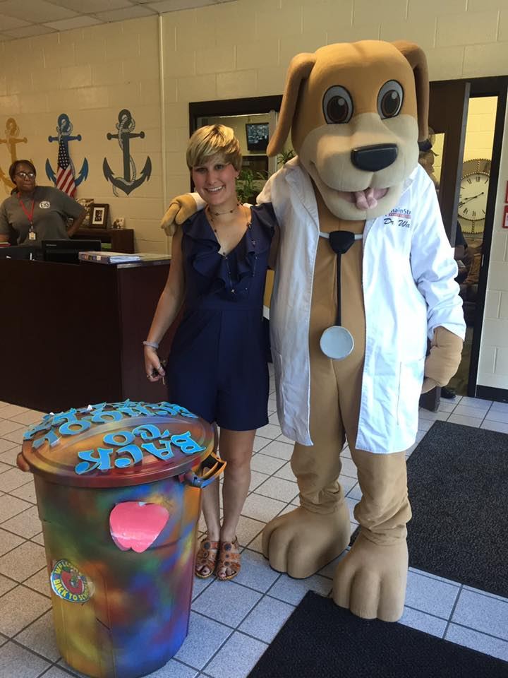 Mainstreet mascot and community educator give school supplies to AMMS middle school