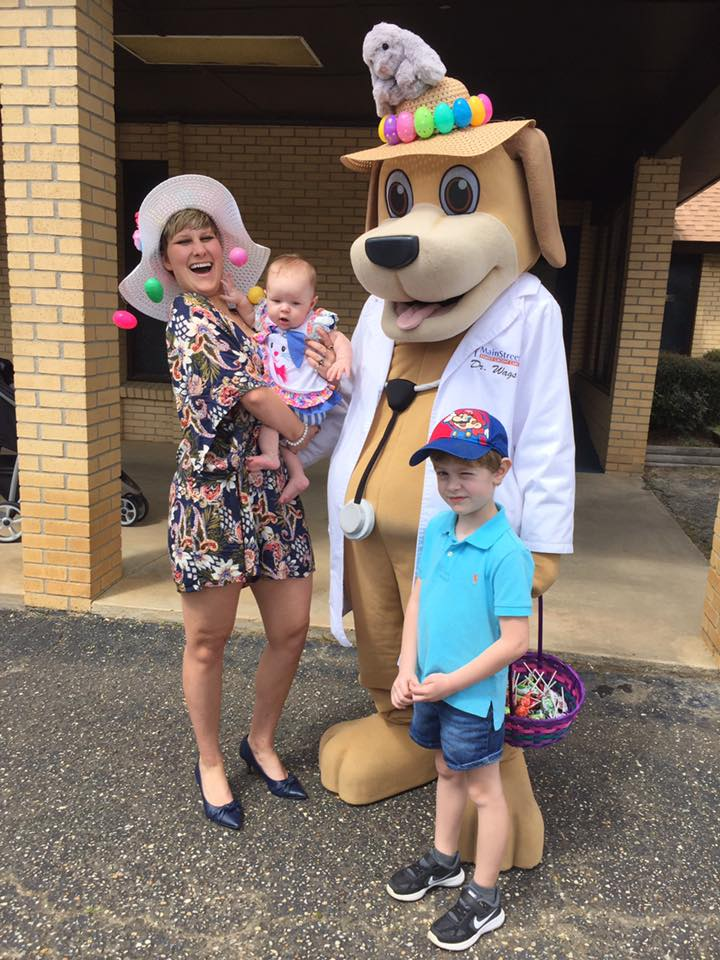 Community Educator and MainStreet Mascot take pictures with children at church on hwy 31 Spring