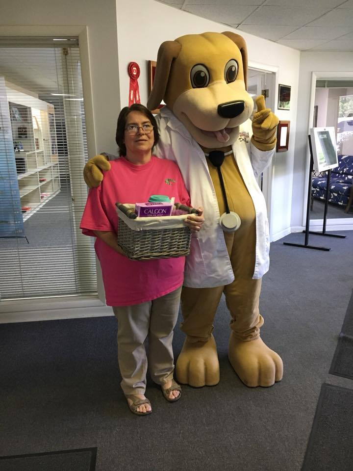 Mother's Day giveaway winner takes pics with MainStreet Mascot and prize in May